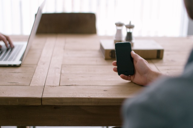 Person smartphone office table